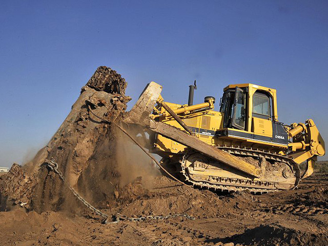 Bulldozer moving a large pile of dirt